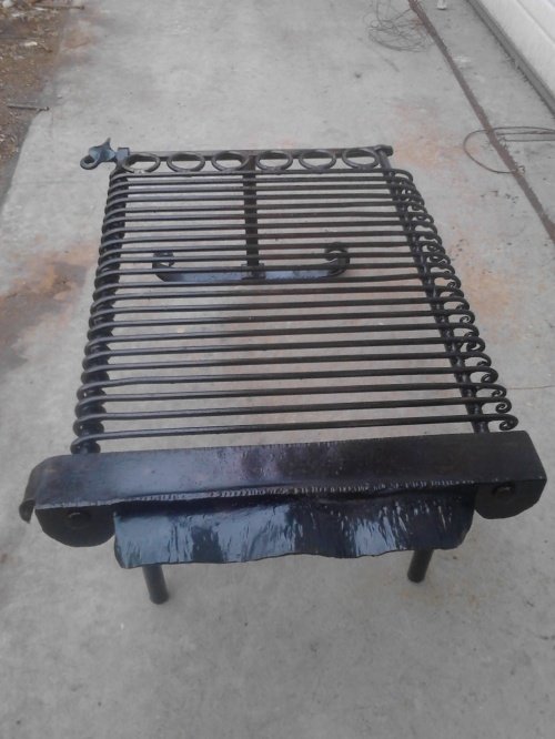 The whole of the grill was wire brushed to bare metal and then heated to 500 degrees and coated with cooking oil to preserve the piece and provide a better cooking surface.